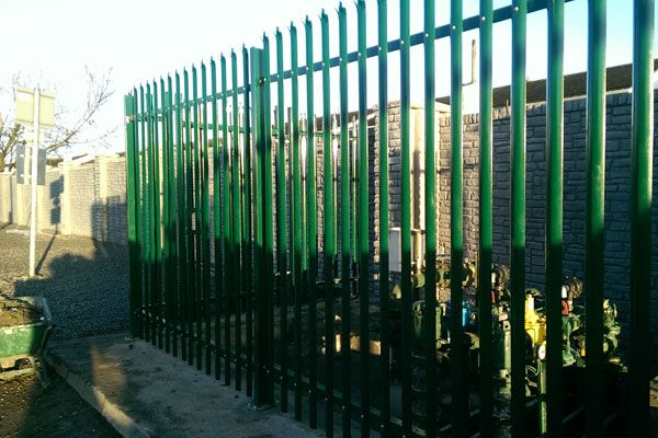 Secure metal fencing surrounding a pump station within a boundary wall. Work carried out by Eugene Foley Construction Limited.
