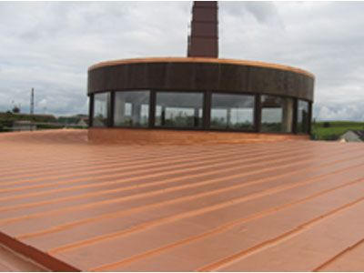 Gleaming copper roof following extensive resoration and repair work on a church roof and steeple in Kilkenny. Work carried out by Eugene Foley Construction Limited.
