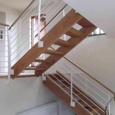 internal section view of a split level open rung metal and timber stairs by Eugene Foley Construction Limited