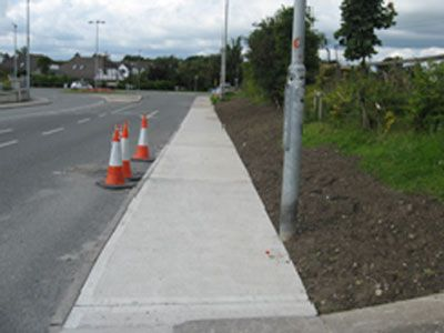 The works entailed the laying of ESB ducting and draw pits along the length of the Bohernatonish Road from the Lidl discount store to the Community Centre at St. Fiacres Church. Vehicle and pedestrian traffic management was conducted accordingly. Works also entailed making good any excavations and reinstating road, footpaths, grass verges. Works carried out by Eugene Foley Construction Limited