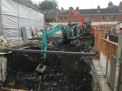 Extensive piling works installed to allow the dig out of a subterranean living space between two other properties by the team at Eugene Foley Construction Limited.