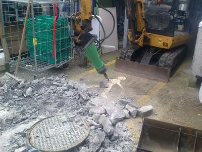 Working indoors, laying pipes in a busy confined space by Eugene Foley Construction Limited